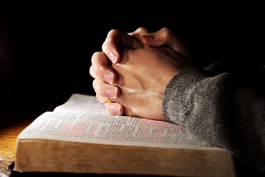 bigstock_Praying_Hands_Man__Bible_2780594